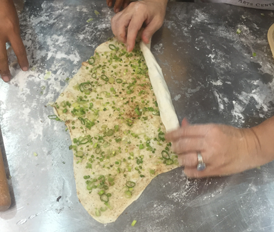 rolling scallion pancakes